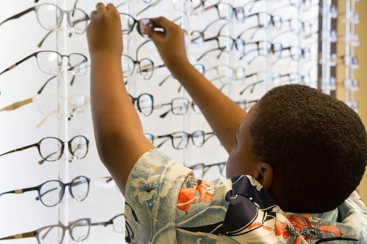 boy picking out eyeglasses at InSight Eyecare Optometry in capitola