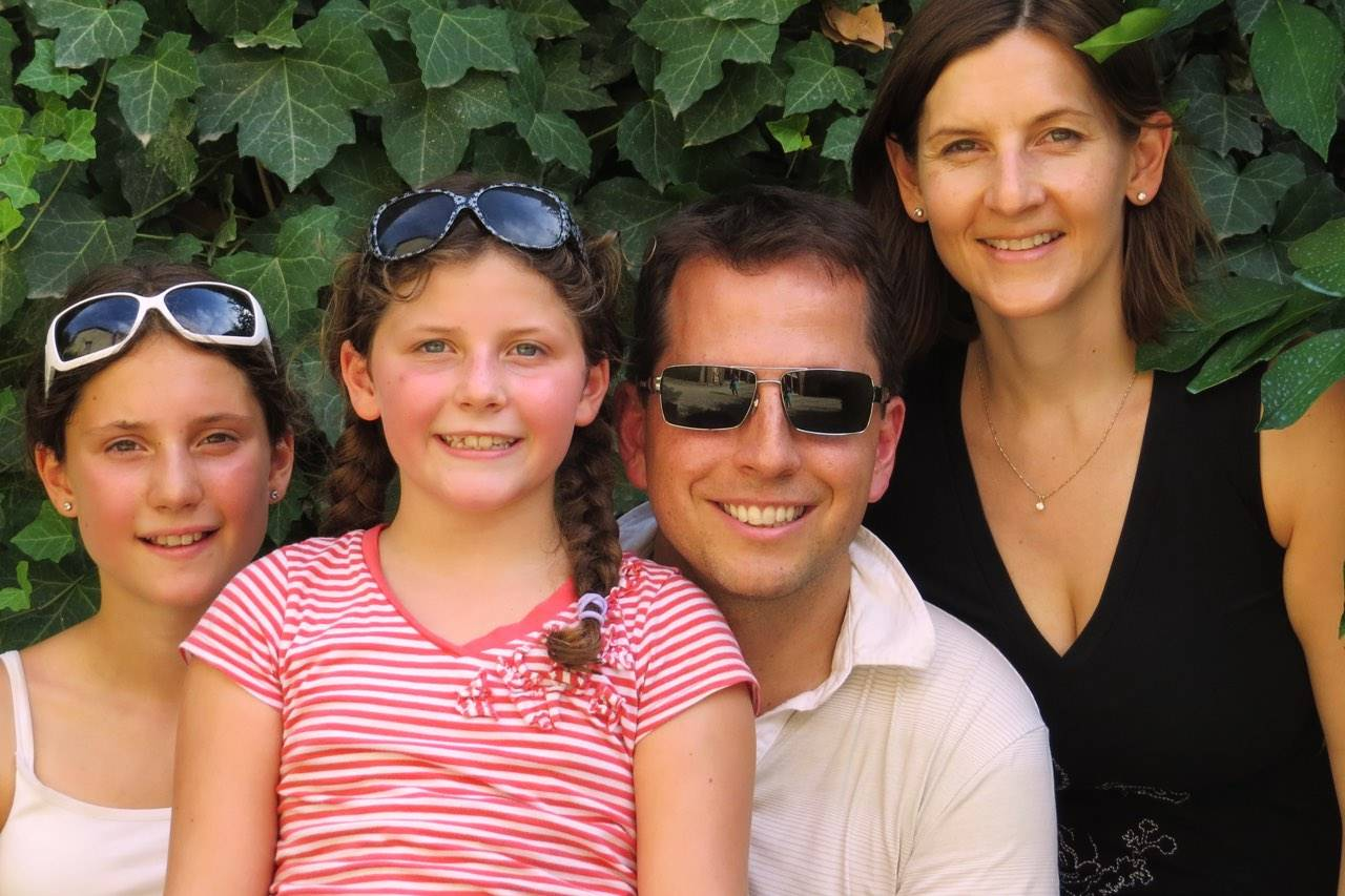 family in bushes with sunglasses