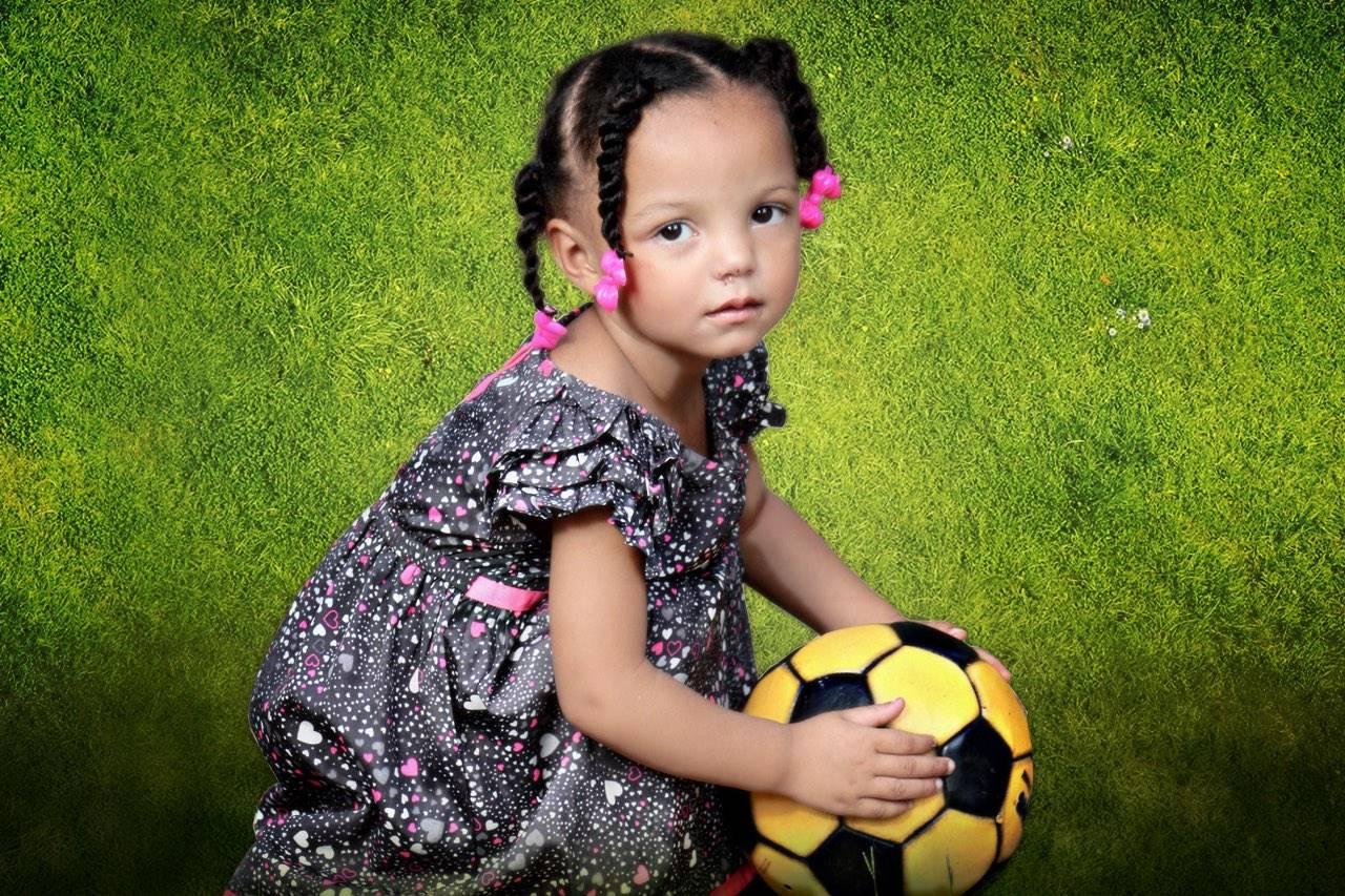 lawn-girl-yellow-ball
