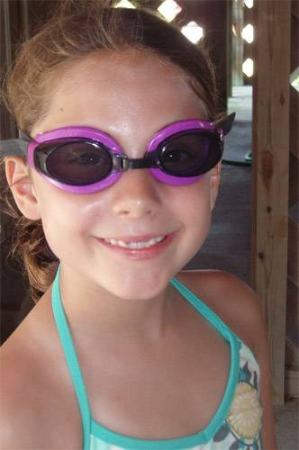 girl with tinted prescription goggles for swimming outdoors in Florida