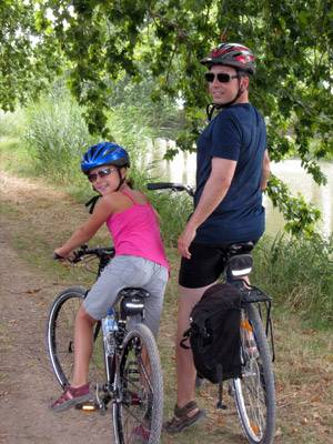 dad riding bike with daughter