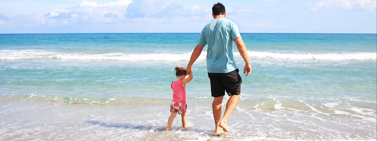 father_daughter_ocean_beach_1280x480