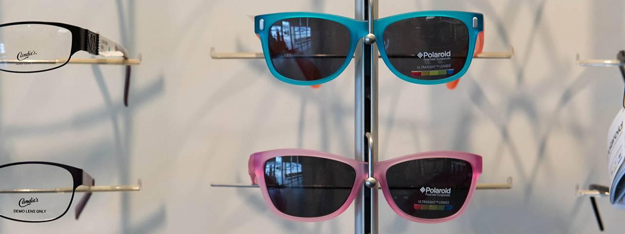 row-of-sunglasses-on-wall-1280x480