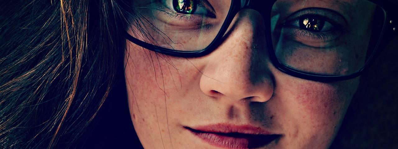 a-woman--smile--glasses