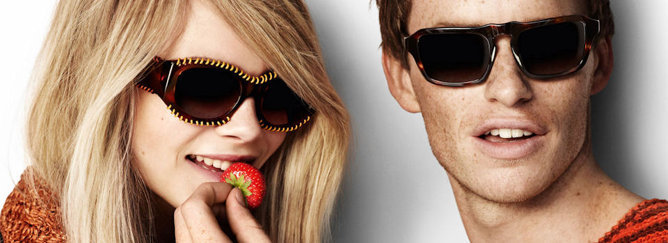 Burberry sunglasses ad with blonde woman and redhead man
