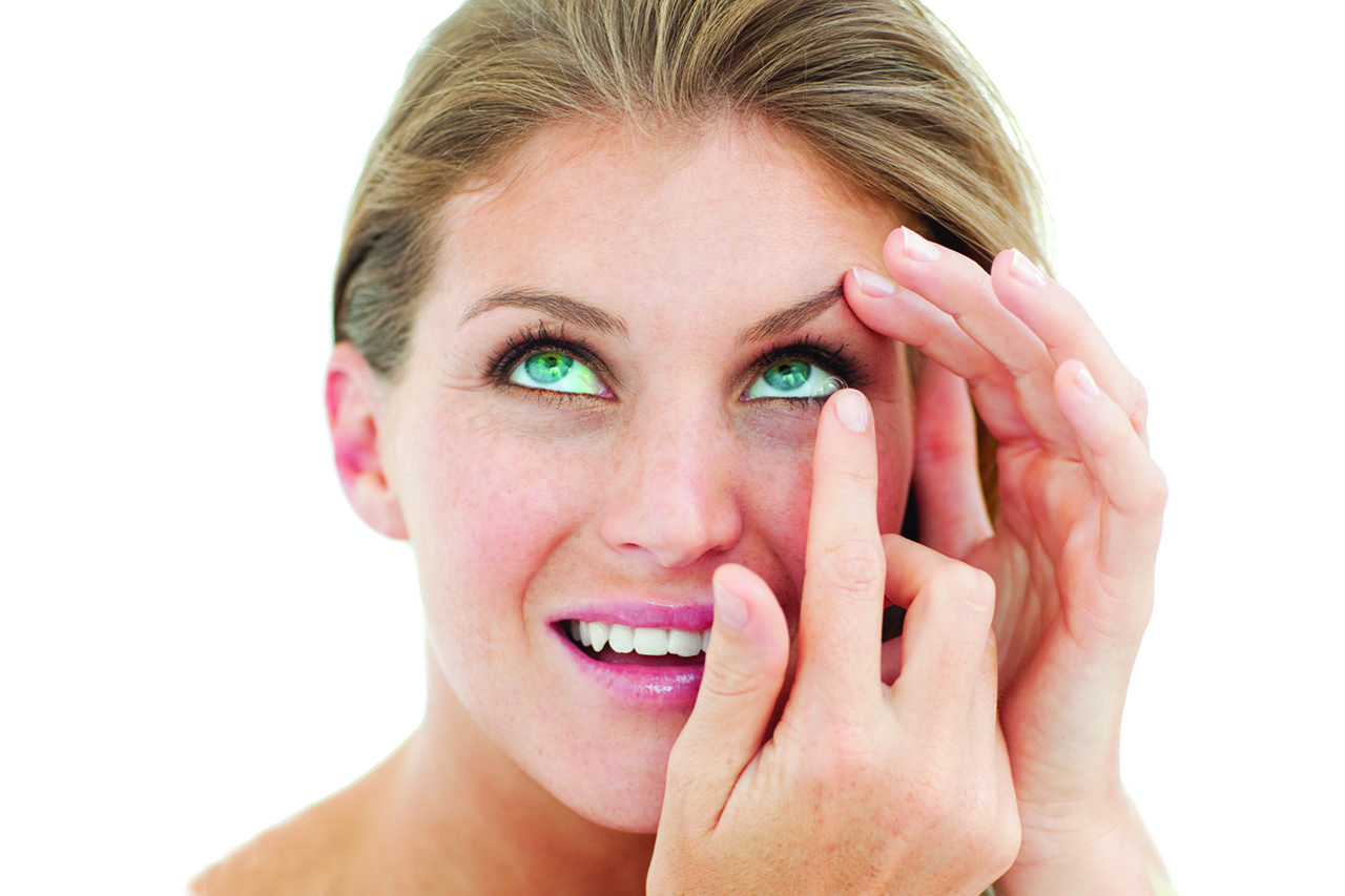 Woman inserting contact lens - Optometrist - Fairfax, VA