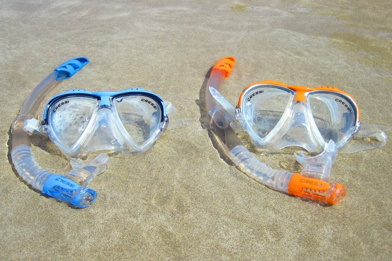 water goggles beach sand