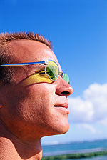 man wearing glasses in the sun in Lake Mary & Orlando, FL