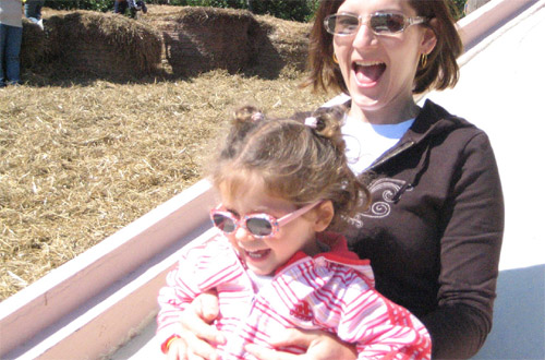 woman and child on a slide wearing sunglasses