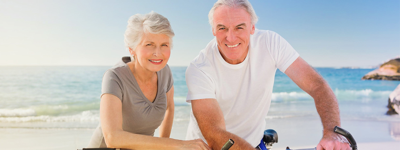 Elderly Man and Woman on Beach, with Macular Degeneration in Jersey City