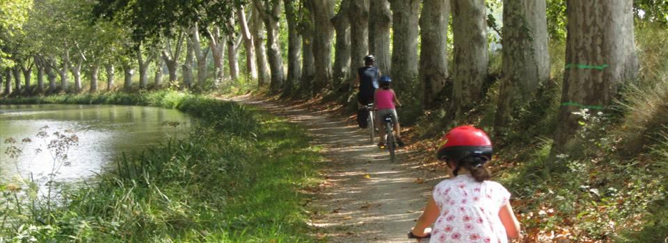 family riding bikes along path