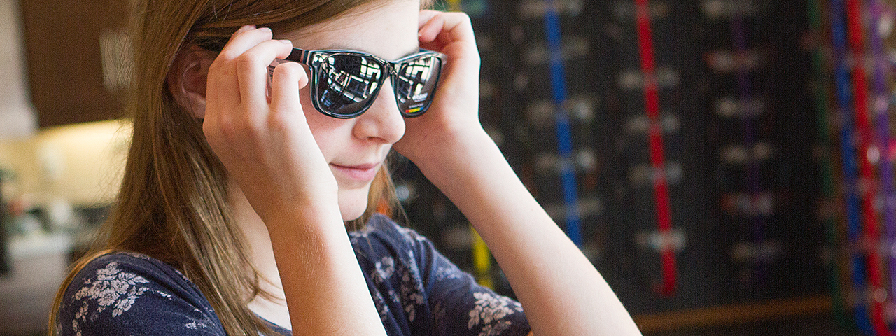 Girl wearing sunglasses in Overland and St. Charles, MO